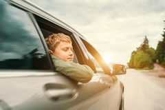 Traveling by auto - son and father look out from car windows Royalty Free Stock Photo