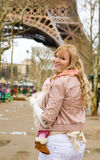 Traveling with baby. Beautiful young mother in Paris, carrying her baby daughter in sling stock image