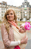 Traveling with baby. Beautiful young mother with her baby daughter in Paris stock photography