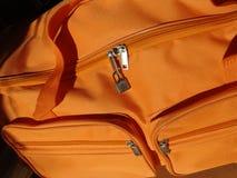 Traveling bag. Detail of an orange bag Stock Images