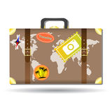 Traveling bag with stickers and world map Royalty Free Stock Photo
