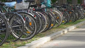 Traveling by bicycle in Europe. Bike parking. A row of bicycles parked on sidewalk. Ecological transportation stock footage