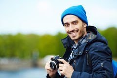 Traveling blogger. Young modern blogger with photocamera stock image