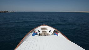 Traveling on board a luxury motor yacht across tropical ocean. View from bow of a large luxury motor boat while sailing across tropical ocean landscape close to stock footage