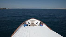 Traveling on board a luxury motor yacht across tropical ocean stock footage