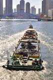 A traveling boat at Sumida River of Tokyo. A view a boat which transport mud in Sumidagawam Tokyo , where boats and river way are still one of the active Royalty Free Stock Photos