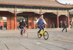 Traveling boys. A boys are sightseeing by bicycle very happily, China royalty free stock photos