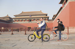Traveling boys. Two boys are sightseeing by bicycle at famous Forbbiden City very happilyinBeijing, China royalty free stock photos