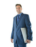 Traveling business man. Standing with laptop Stock Image