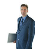 Traveling business or sales man. Standing with laptop with a smile Royalty Free Stock Image