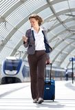 Traveling business at train station Royalty Free Stock Photos