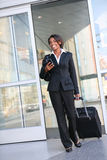 Traveling Business Woman. An attractive african american business woman traveling Stock Photography