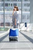 Traveling business woman walking with bag and mobile phone Stock Image