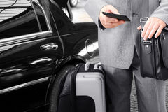 Traveling Businessman Calling by Phone Stock Photo