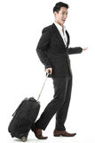 The traveling businessman. The excited traveling businessman with his traveling bag Stock Photos