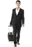 The traveling businessman. The excited traveling businessman with his traveling bag Stock Photo