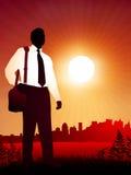 Traveling Businessman on sunset background Royalty Free Stock Photography
