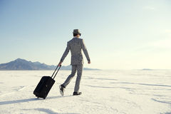 Traveling Businessman Walking with Luggage Stock Photography