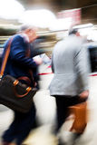 Traveling businessmen at the railway station Royalty Free Stock Images