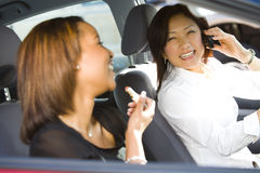 Traveling Businesswomen. A metaphorical image of two happy businesswomen traveling in a car Stock Images