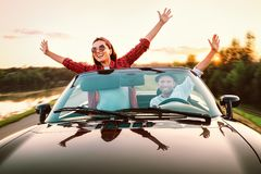 Traveling by car - happy couple in love go by cabriolet car in s stock photos