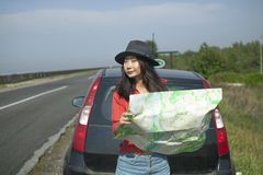 Traveling by car with a map on the road royalty free stock photography