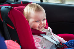 Traveling in the car safety seat Stock Images