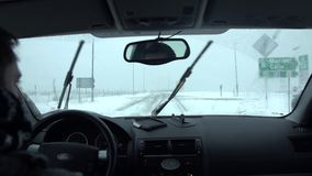 Traveling with a car on a snowy day stock video footage