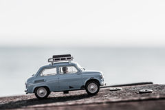 Traveling in a car with their luggage tied on top. Macro photo.  Stock Photo