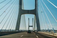 Traveling By Car To Lisbon City On Vasco Da Gama Bridge Stock Photos