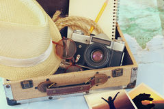 Traveling concept. camera, cup of coffee, sunglasses, fedora hat and notebook. vintage style filtered. selective focus Royalty Free Stock Images