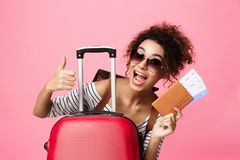 Traveling Concept. Girl Showing Thumb Up Over Pink Background royalty free stock photos