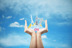 Traveling concept. Male hands holding travel sketch on sky background. Traveling concept Stock Photo