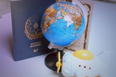 Traveling concept,passport globe and toy airplane on the white background Stock Image