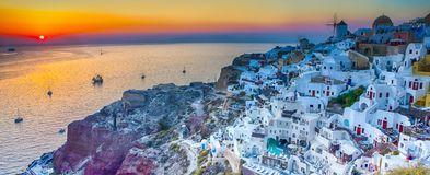 Traveling Concepts. Panoramic View of Famous Old Town of Oia or. Ia at Santorini Island in Greece. Taken During Blue Hour with Traditional White Houses and stock image
