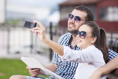 Traveling  Concepts. Smiling and Happy Caucasian Couple in Love Royalty Free Stock Images