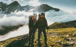 Traveling Couple climbing together in mountains. Love and adventure Lifestyle wanderlust friendship concept outdoor Stock Photo