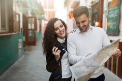 Traveling couple enjoying city Stock Photo