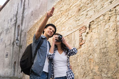 Traveling couple having a walk on bohemian street in Europe Royalty Free Stock Photo