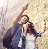 Traveling couple of hipsters: walking around old town Royalty Free Stock Photos