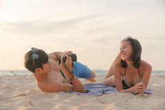 Traveling couple in love making self portrait by digital camera. Having fun on amazing tropical beach Stock Image