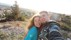 Traveling couple making selfie. Happy traveling couple making selfie stock video footage