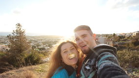 Traveling couple making selfie. Happy traveling couple making selfie stock video