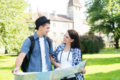 Traveling couple searching for their next destination with a map Stock Photo
