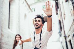 Traveling couple of tourists walking around old town. Vacation, summer, holiday, tourism: concept Stock Image