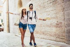 Traveling couple of tourists walking around old town. Vacation, summer, holiday, tourism: concept Royalty Free Stock Photography