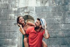 Traveling couple of tourists walking around old town. Vacation, summer, holiday, tourism: concept Stock Photo