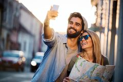 Traveling couple of tourists walking around old town. Vacation, summer, holiday, tourism concept. Traveling couple of tourists walking around town. Vacation royalty free stock photography