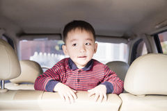 Traveling. Cute boy traveling by car royalty free stock image