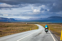 Traveling cyclist in Iceland royalty free stock images